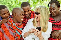 Woman Showing Cell Phone to Group of Masai Men Stock Photo - Premium Rights-Managednull, Code: 700-03893465