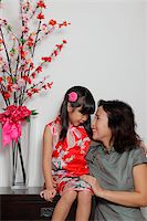 singapore traditional costume lady - Chinese mother and daughter wearing Cheongsams looking at eachother Stock Photo - Premium Rights-Managednull, Code: 849-03901212