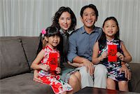 singapore traditional costume lady - Chinese family sitting together with daughters holding red envelopes (Hong Bao) Stock Photo - Premium Rights-Managednull, Code: 849-03901235