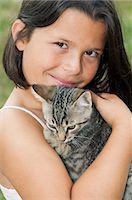 preteen girl pussy - Girl holding pet cat, portrait Stock Photo - Premium Royalty-Freenull, Code: 614-03903189