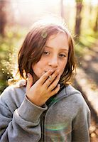 A girl pretending to smoke, Sweden. Stock Photo - Premium Royalty-Freenull, Code: 6102-03903957