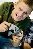 Two teenagers playing a video game. Stock Photo - Premium Royalty-Freenull, Code: 6102-03904675