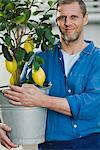 Man with a lemon tree. Stock Photo - Premium Royalty-Free, Artist: Aurora Photos, Code: 6102-03905321