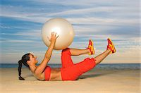 Woman exercising with fitness ball Stock Photo - Premium Royalty-Freenull, Code: 6102-03905736