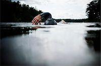 forward - Woman swimming in water Stock Photo - Premium Royalty-Freenull, Code: 6102-03905782