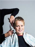 Boy getting haircut Stock Photo - Premium Royalty-Freenull, Code: 6102-03905907