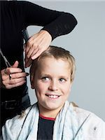 Woman cutting boys hair Stock Photo - Premium Royalty-Freenull, Code: 6102-03905908