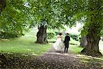 Bride and groom walking in park Stock Photo - Premium Royalty-Free, Artist: Robert Harding Images, Code: 6102-03905933