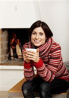 sweater and fireplace - Woman drinking tea near fireplace Stock Photo - Premium Royalty-Freenull, Code: 6102-03905998