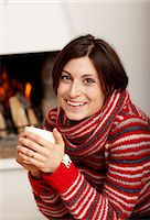 sweater and fireplace - Woman drinking tea near fireplace Stock Photo - Premium Royalty-Freenull, Code: 6102-03905999