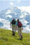 Backview of Couple Hiking, Bernese Oberland, Switzerland