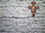 cheap plaster crucifix hanging on rustic wall Stock Photo - Royalty-Free, Artist: friendlydragon, Code: 400-03907816