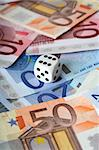 Colorful euro banknotes and a dice Stock Photo - Royalty-Free, Artist: mikdam, Code: 400-03910992