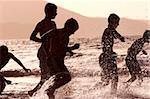 Group of boys running through shallow water at sunset Stock Photo - Royalty-Free, Artist: Spanishalex, Code: 400-03912061