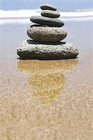 Pebble stack by the seashore Stock Photo - Royalty-Freenull, Code: 400-03913981