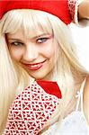pretty girl in santa helper hat over white Stock Photo - Royalty-Free, Artist: dolgachov, Code: 400-03914355