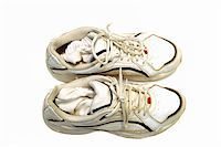 A pair of sneakers against a ahite background Stock Photo - Royalty-Freenull, Code: 400-03915269