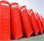 Classic British red telephone box in group