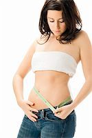 fat italian woman - cute young woman measuring her body with a scale a tape measure Stock Photo - Royalty-Freenull, Code: 400-03915881