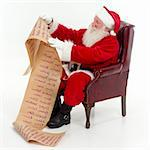 Santa Claus seated in a chair checking his list of boys and girls, white background, square Stock Photo - Royalty-Free, Artist: scotthancock, Code: 400-03919054