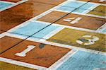 Detail of worn hopscotch course, with numbers Stock Photo - Royalty-Free, Artist: marmalade, Code: 400-03919912