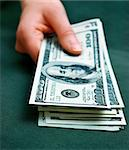 hand holding some money. Shallow DOF Stock Photo - Royalty-Free, Artist: AlexStar, Code: 400-03920576