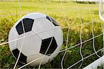 photo of a Soccer ball upon the green grass Stock Photo - Royalty-Free, Artist: Gelpi, Code: 400-03920718