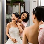 African-American woman helping Asian bride with hair. Stock Photo - Royalty-Free, Artist: iofoto, Code: 400-03920952