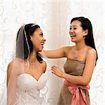 Asian bridesmaid laughing with African-American bride. Stock Photo - Royalty-Free, Artist: iofoto, Code: 400-03920961