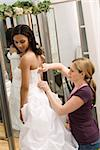Caucasian seamstress helping African-American bride in bridal shop. Stock Photo - Royalty-Free, Artist: iofoto, Code: 400-03920971