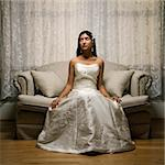 Portrait of an Indian bride sitting on a love seat. Stock Photo - Royalty-Free, Artist: iofoto, Code: 400-03920985