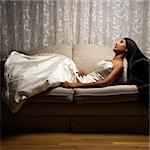 Portrait of an Indian bride lying on love seat. Stock Photo - Royalty-Free, Artist: iofoto, Code: 400-03920988