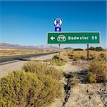 Road sign on side of desert road with direction to Badwater, Death Valley. Stock Photo - Royalty-Free, Artist: iofoto, Code: 400-03923790