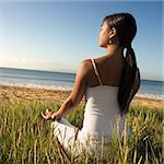 Young Asian female sitting on beach meditating and looking out to ocean. Stock Photo - Royalty-Free, Artist: iofoto, Code: 400-03924127