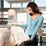 African American female shopping for plates in retail setting. Stock Photo - Royalty-Free, Artist: iofoto, Code: 400-03924716