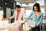 African American couple shopping in a home furnishings retail store. Stock Photo - Royalty-Free, Artist: iofoto, Code: 400-03924717