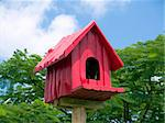Red birdhouse against a background of blue sky and green trees Stock Photo - Royalty-Free, Artist: epixx, Code: 400-03928076