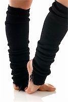 feet gymnast - legs in black knee socks warming up  Stock Photo - Royalty-Freenull, Code: 400-03931117
