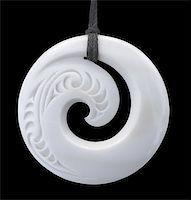 Modern Maori koru design bone pendant with clipping path Stock Photo - Royalty-Freenull, Code: 400-03932035