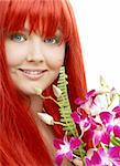 bright picture of lovely redhead with orchid Stock Photo - Royalty-Free, Artist: dolgachov, Code: 400-03933817