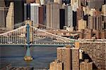 Aerial view of New York City's Manhattan Bridge with Brooklyn Bridge and Manhattan buildings in background. Stock Photo - Royalty-Free, Artist: iofoto, Code: 400-03935333