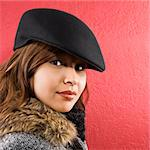 Young adult Caucasian woman wearing flat hat looking at viewer. Stock Photo - Royalty-Free, Artist: iofoto, Code: 400-03937658