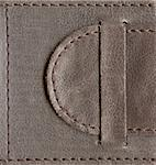 brown textured leather lock, belt stitched by thread over edges, high-resolution scan Stock Photo - Royalty-Free, Artist: yuriz, Code: 400-03938861