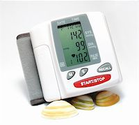 Closeup of a blood pressure measuring device supported by some seashells Stock Photo - Royalty-Freenull, Code: 400-03942425