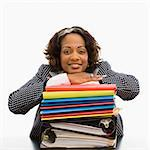 Businesswoman resting head on large stack of work smiling. Stock Photo - Royalty-Free, Artist: iofoto, Code: 400-03949206