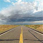 Empty two lane highway leading to desert horizon. Stock Photo - Royalty-Free, Artist: iofoto, Code: 400-03949239