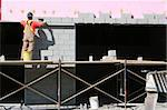A worker lays another row of cement blocks for a new big box retailer. Stock Photo - Royalty-Free, Artist: robcocquyt, Code: 400-03949442