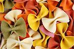 Many different flavors of fresh farfalle pasta. Italian food background. Stock Photo - Royalty-Free, Artist: sirylok, Code: 400-03950961