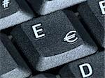 Closeup of the euro key on a keyboard Stock Photo - Royalty-Free, Artist: devulderj, Code: 400-03960278