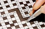 Close-up of a woman' s hand filling in a crossword puzzle Stock Photo - Royalty-Free, Artist: paulmaguire, Code: 400-03962842